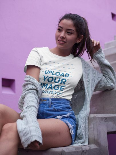 Beautiful Girl Wearing a T-Shirt Mockup While Sitting on Concrete Stairways a17478