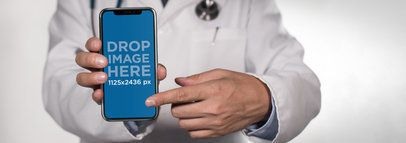 iPhone X Mockup Being Shown by a Doctor a17563