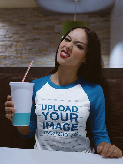 Girl Drinking a Soda Wearing a Raglan Tee Mockup a17518