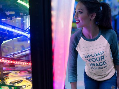 Girl About to Win a Prize Wearing a Raglan Tshirt Mockup a17522
