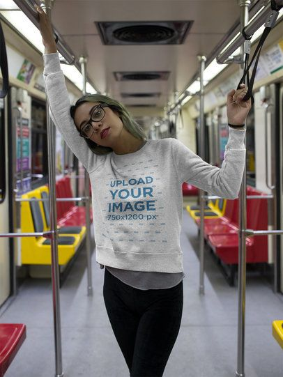Girl Wearing a Crew Neck Sweatshirt Template While in the Metro a17653