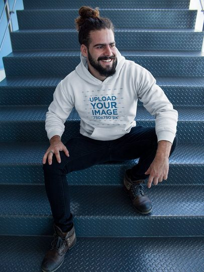 Pullover Hoodie Mockup Being Worn by a Man on Metal Stairs a17760
