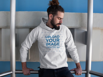 Hipster Man Holding on to a Rail Wearing a Pullover Hoodie Template a17759