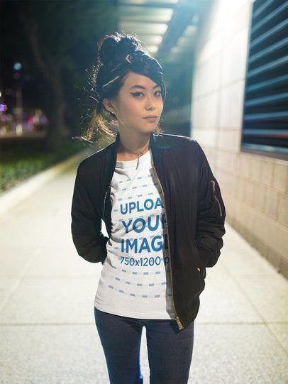 Urban Asian Woman Walking on the Street Wearing a T-Shirt Mockup a17812