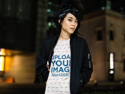 Beautiful Asian Woman Wearing a Round Neck Tee Mockup While Walking at Night a17783