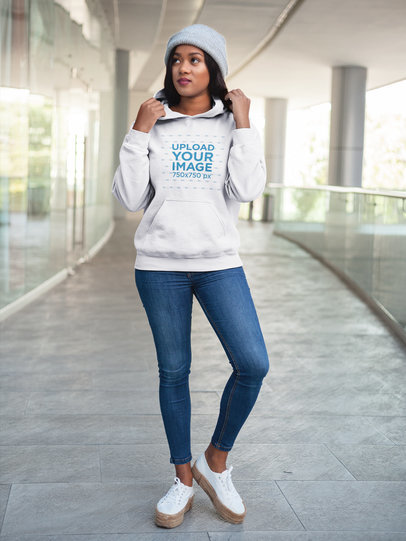 Pretty Black Woman Wearing a Pullover Hoodie Mockup While at a Shopping Center a17747