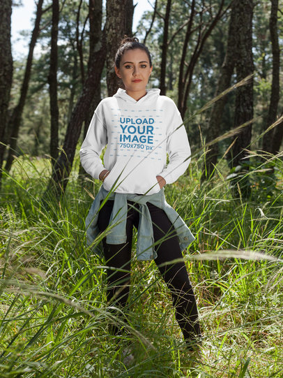 Girl Wearing a Pullover Hoodie Mockup While at a Forest a17677