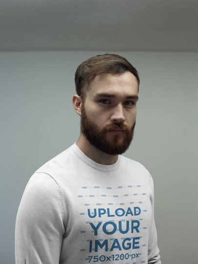 Serious Man Wearing a Crewneck Sweatshirt Template While Standing Inside a Room a17735