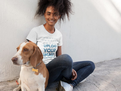 Happy Black Girl Wearing a Tshirt Template while Sitting with her Dog a17845