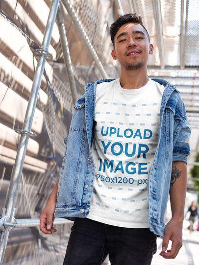 Asian Man Wearing a Tshirt Template While on a Bridge a17798