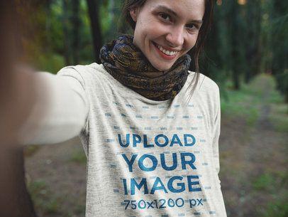 Selfie of a Happy Girl Wearing a Bella Canvas Flowie Long Sleeve Tee Mockup a17908