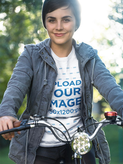 Girl Wearing a Round Neck Tshirt Mockup While Riding her Bike a17935