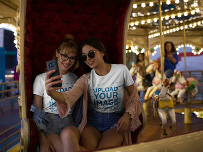 Girlfriends Wearing T-Shirts Mockup While in a Carousel a17888