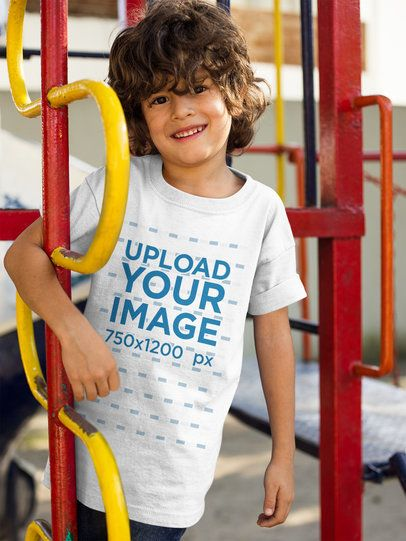 Boy with Curly Hair Wearing a Tshirt Mockup While Smiling a17872