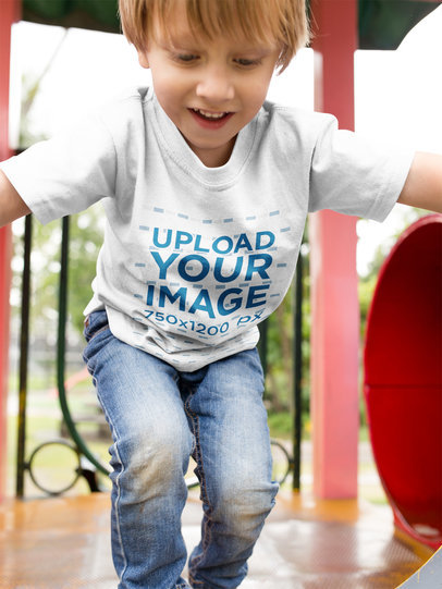 Small Kid at the Playground Wearing a Round Neck Tee Mockup a17941