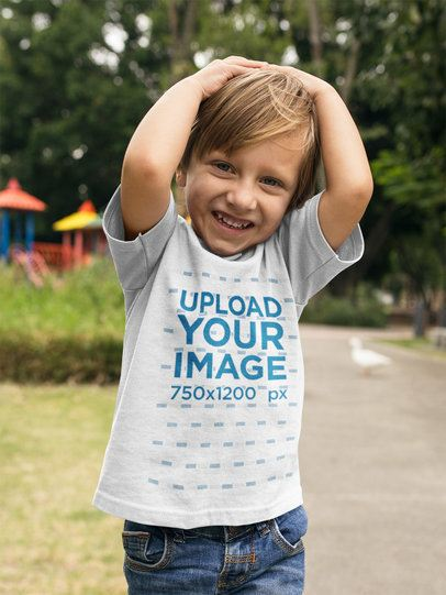Boy Wearing a T-Shirt Mockup While at a Park with Ducks a17942