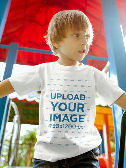 Blonde Kid Wearing a Tshirt Mockup while at the Playground a17950