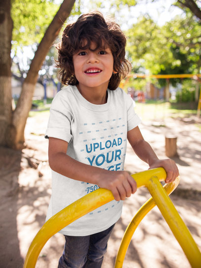 Smiling Kid Wearing a Tshirt Mockup while at a Playground a17870