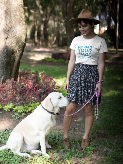 Beautiful Girl Wearing a Round Neck T-Shirt Mockup While Walking her Dog at a Park a17978