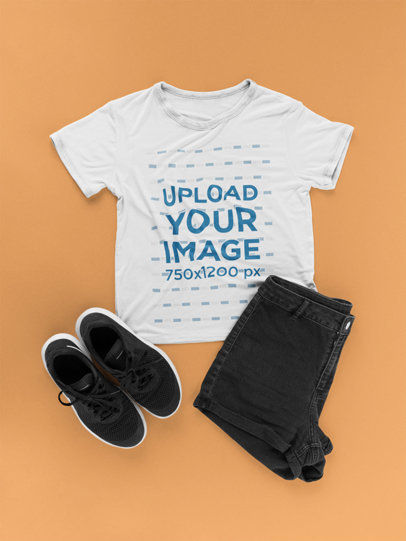 T-Shirt Mockup Next to a Men's Flat Lay Outfit a17959