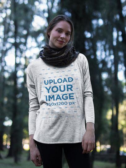 Beautiful Girl Wearing a Bella Canvas Flowy Long Sleeve Tee Mockup in the Woods a17922
