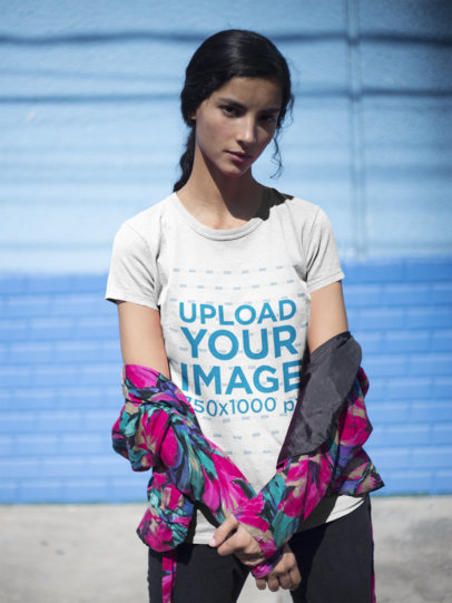 Serious Girl Wearing a Tshirt Mockup Against a Blue Wall a18434