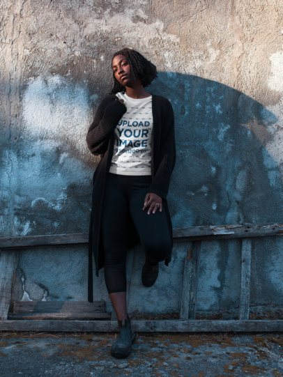 Short Haired Woman Wearing a Round Neck Tee Mockup Lying Against a Concrete Wall a18563