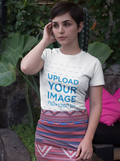 Short Haired Girl Wearing a Round Neck Tee Mockup Standing Against Plants a18446