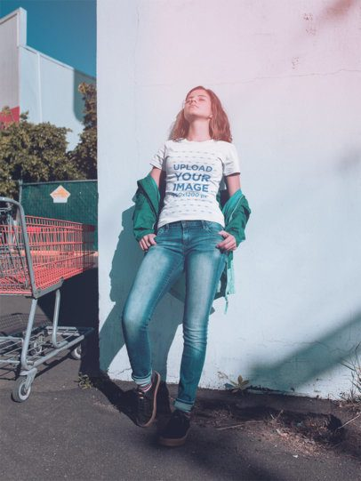 T-Shirt Mockup of a Woman Leaning Against a Wall Outside a Supermarket a18477