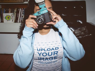 Girl Taking a Photo at Night Wearing a T-Shirt Mockup in her Room a18818