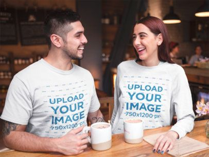 Happy Couple at a Coffee Shop Wearing a T-Shirt and a Crewneck Sweatshirt Mockup on Valentine's Day a19006