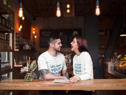 Happy Couple Wearing a T-Shirt and a Crewneck Sweater Mockup while on a Date in Valentine's Day a19005