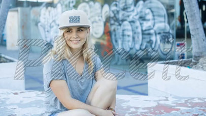 Happy Blonde Girl Wearing a Snapback Hat Video Mockup while at a Skating Park a14137