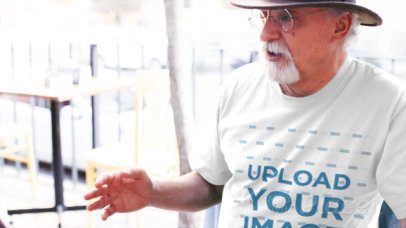 Elderly Man Having a Conversation in the Street Wearing a T-Shirt Video a12782