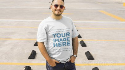 Young Man Styling a Plus Size T-Shirt Video with Sunglasses in a Parking Lot a12463