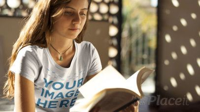 Girl Wearing a Round Neck Tee Holding a Book with Moving Pages in Stop Motion a13319