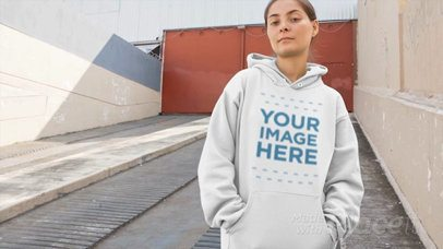 Woman Wearing a Pullover Hoodie Video Standing on an Industrial Ramp a13110