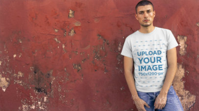 Man Wearing a T-Shirt Video Mockup Standing Against an Old Wall a12233