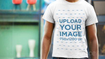 Black Man Standing in the Street Wearing a T-Shirt Closeup Video Mockup a12355b