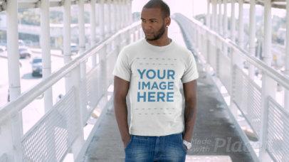 Stylish Black Man Waiting on a City Bridge Wearing a T-Shirt Video Mockup 12876b