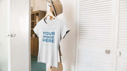 T-Shirt Mockup Video of a Tee Hanging on a Coat Stand a13089
