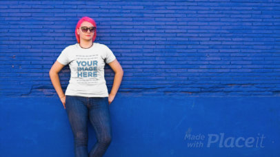 Girl with Pink Hair Wearing a Round Neck Plus Size Tee and Leaning Against a Bright Blue Wall a12651
