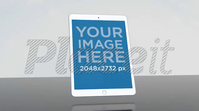 White iPad Video Mockup Floating Inside a White Room a15699