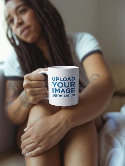 Girl with Dreadlocks Holding a Mug Mockup Watching to the Window a17304