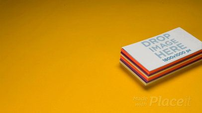 Pile of Business Cards Video Mockup Lying over a Yellow Background a13965