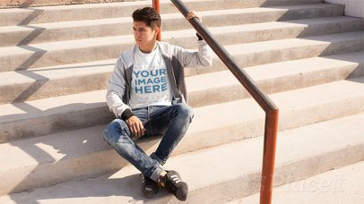 Young Man on Some Stairways Wearing a T-Shirt Stop Motion and a Full Zip Hoodie a13504