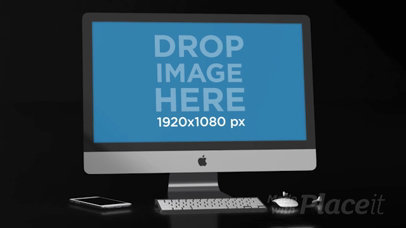 Video of an iMac Lying in a Black Room Near an iPhone and Earpads a15827b