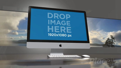 Video of an iMac Standing in an Office Room with a Landscape Image in the Back a15825b