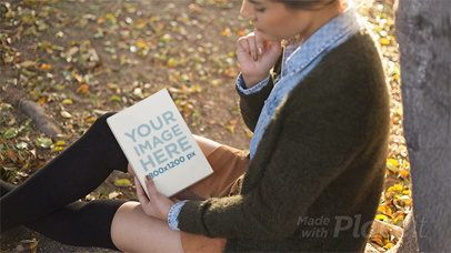 Young Woman Reading a Book in Stop Motion While at a Park In Autumn a13746