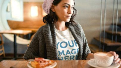 Pretty Girl Having a Latte Wearing a Round Neck Tee Cinemagraph Mockup a13443